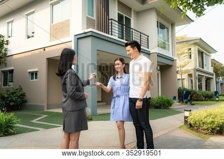 Asian Happy Smile Young Couple Take Keys New Big House From Real Estate Agent Or Realtor In Front Of