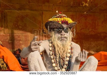 Varanasi, India - March 18, 2019: Naga Sadhu Holy Man On The Street In Varanasi