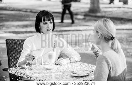 Closest People. Girls Friends Drink Coffee Talk. Conversation Women Cafe Terrace. Friendship Friendl