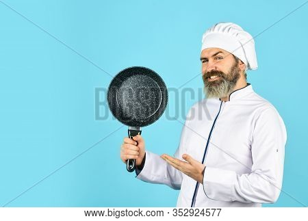 Teflon Might Be Toxic. Nonstick Pan For Frying. Enameled Cooking Vessels. Man Hold Pan. Frying Meal.