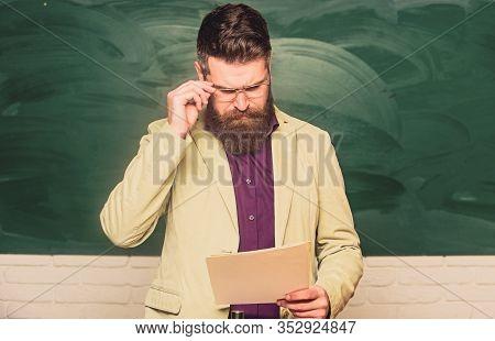 Prepare For Test. Teacher Bearded Man Hold Documents Chalkboard Background. Teacher Paperwork. Schoo