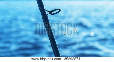 Fishing Rod Spinning Rod With The Line Close-up. Fishing Rod. Fishing Tackle. Fishing Spinning Reel