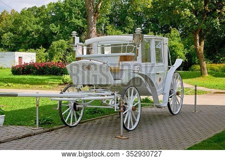 Belarus, Zalesie August 2019. An Old Carriage For Walking. The Carriage Is White.