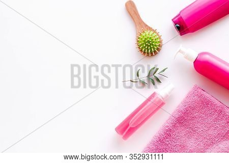 Hair Care Set With Shampoo And Towel - Pink - On Whiite Background Top-down Frame Copy Space