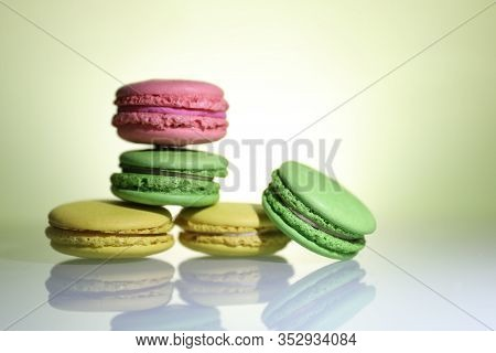 Five Colored Macaroons On The Wite Table