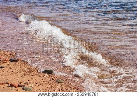 Soft Focus Sand Stone Ground Coast Line Sea Side Beach With Water Waves Fuzzy Surface Outdoor Scenic