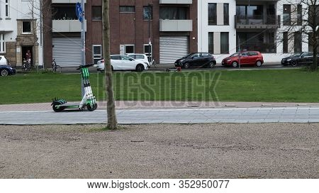 Dusseldorf, Germany - February 20, 2020. E-mobility In Germany: E-scooters Await Customers On A Pede