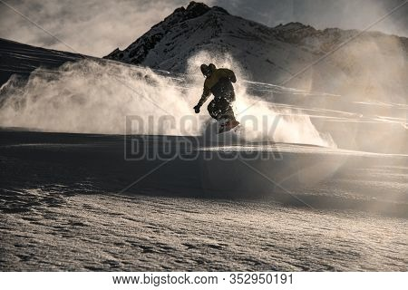 Male Freerider Riding On A Picturesque Mountain Side