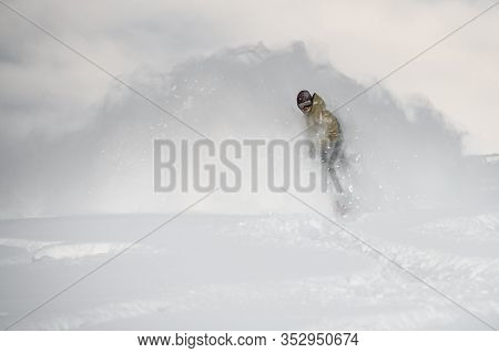 Freerider Slides On A Snowboard Through Snow Cloud
