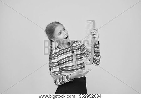 Professional Equipment. Combing Hair. Cheerful Happy Smiling Little Kid With Giant Comb. Comb For Ta