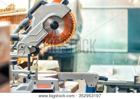 Professional Compound Mitre Circular Saw At Emnty Woodcraft Carpentry Workshop. Diy Carpenter Woodwo