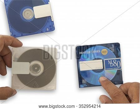 Isolate Mini Disc Md In Hand. Put On White Background For Data And Music Recording, Concept Music Pl