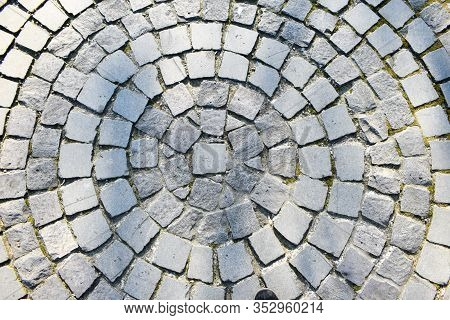 Background With Cubic Stone From Alexandru Ioan Cuza Park From Bucharest. Top View