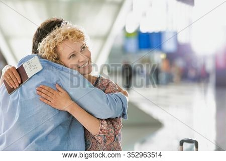 Wife reuniting with his husband in airport