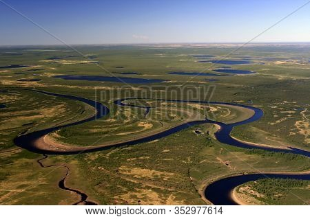 Northern Tundra Of The Taimyr Peninsula View From A Helicopter. Rivers, Lakes And Swamps In The Arct