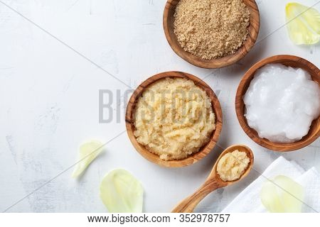 Sugar Body Scrub With Ingredients On White Stone Table. Homemade Cosmetic For Spa.