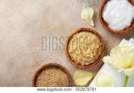 Sugar Body Scrub With Ingredients On Stone Table. Homemade Cosmetic For Spa.