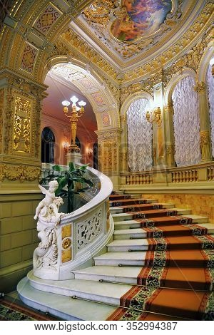 Saint Petersburg, Russia - January 29, 2020: Ancient Marble Staircase And Golden Decorative Panels I