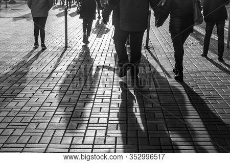 Kyiv, Ukraine - Nov. 10, 2018: Light And Shadows In Kyiv. Silhouettes Of People Walking The Streets
