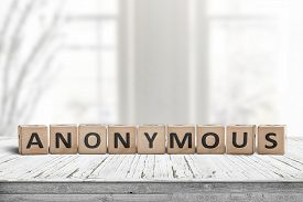 Sign With The Word Anonymous On A Worn Desk In A Bright Room