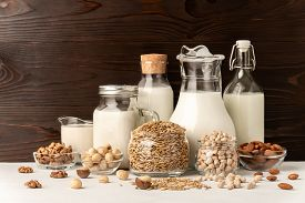 Different Types Of Lactose-free Vegetarian Dairy Products. Milk From Macadamia, Chickpeas, Oats, Wal
