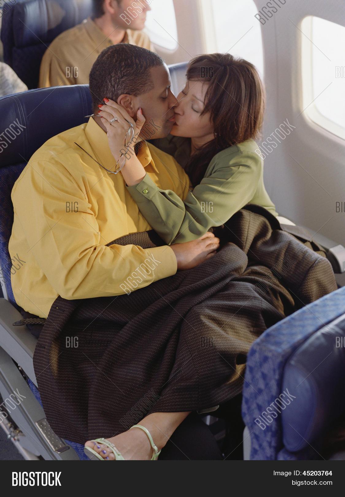 mature couple kissing cuddling on image & photo | bigstock