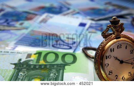 Hand Watch And Euro Bills