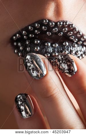 Close-up Photo Of Metallic Lips And Minx Nails