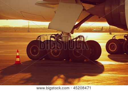 Wheels Of The Airplane At The Sunset