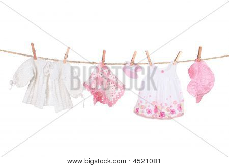 Baby Girl Clothing Hanging On A Clothesline