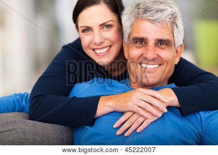 happy loving middle aged couple relaxing at home