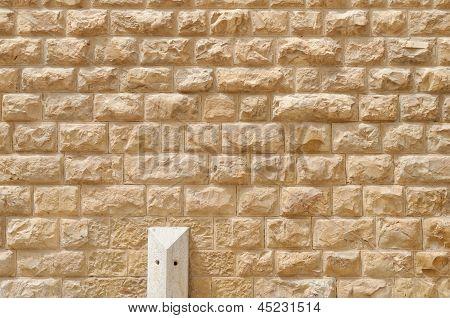 Textur der Mauer aus groben gelb Steinblöcken gebaut
