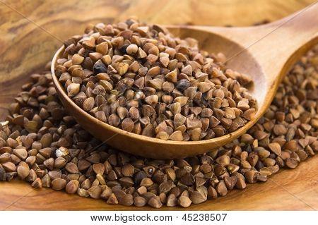 Buckwheat Seeds On Wooden Spoon In Closeup