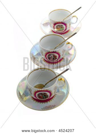 Three Refined Cups With Saucers