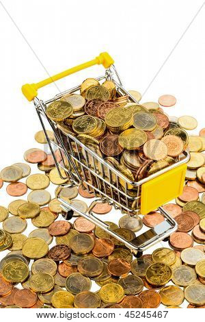 a shopping cart is filled with well-euro coins, symbolic photo for purchasing power and consumption