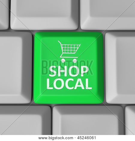 A green computer key with the words Shop Local and a shopping cart to encourage you to support your community by spending money in your home town