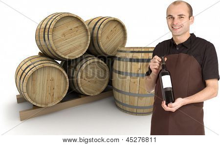 Young man presenting a wine bottle, with barrels at the background