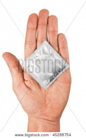 Condom in hand, isolated on white background