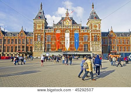 AMSTERDAM, NETHERLANDS - APRIL 30: Decorated central station in Amsterdam Netherlands on occasion of the coronation of the new king Willem Alexander from the Netherlands