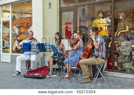 Sttring Quartet Playing On The Street