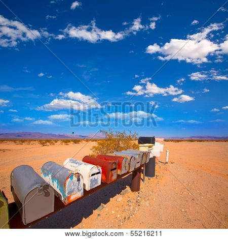 Grunge mail boxes in a row at California Mohave desert USA