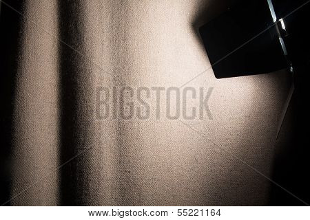 poster of Spotlight shines rough cloth curtain scene. Background for posting information