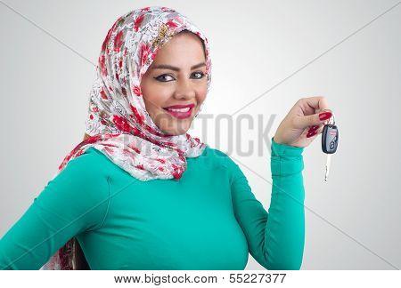 Arabian woman holding car keys
