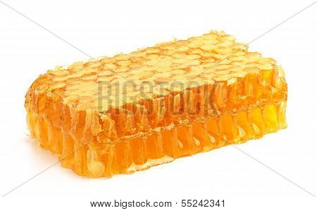 Fresh honey in the comb close-up isoleted on white background. poster