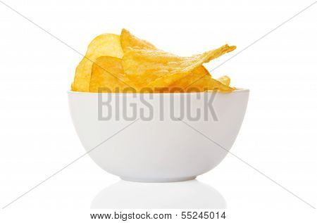 Appetizing, golden chips in the faience bowl