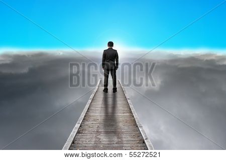 Businessman Standing On Pier Looking Sunrise With Clouds, Blue Sky