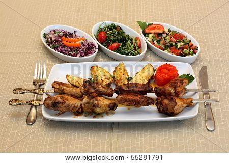 Grilled chicken legs with potatoes