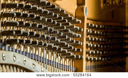 Detail Of  An Upright Piano Tuning Wrench Sockets