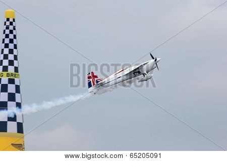 PUTRAJAYA, MALAYSIA - MAY 17, 2014: Paul Bonhomme from Great Britain flies his Edge 540 V2 plane through the race course during the qualifying session of the Red Bull Air Race World Championship 2014.