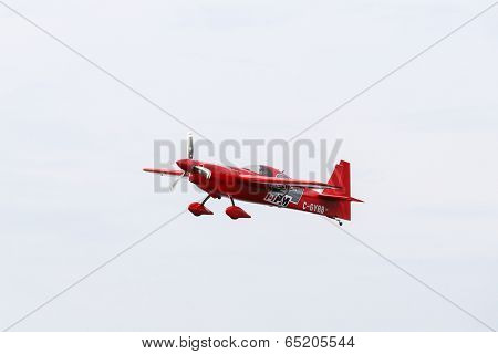 PUTRAJAYA, MALAYSIA - MAY 17, 2014: Pete McLeod from Canada in an Edge 540 V3 plane takes to the skies over Putrajaya lake at the Red Bull Air Race World Championship 2014.